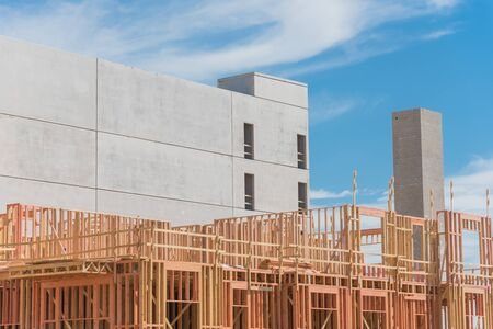 Podium construction of urban apartment complex with above-grade multi-story parking garage in Dallas, Texas, USA