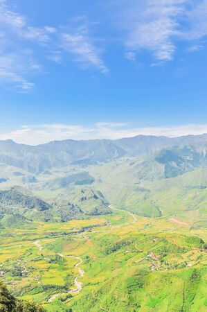 Aerial view of mountain layers surrounds a remote town in Mu Can Chai, Yen Bai, Vietnam