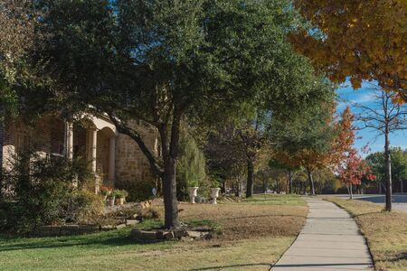 Colorful sidewalk pathway in residential area suburban Dallas, Texas, USA in fall season