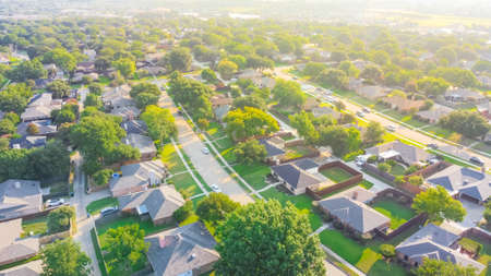 Aerial view urban sprawl subdivision near Dallas, Texas, USA row of single family homes large fenced backyard
