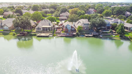 Aerial view luxury waterfront houses with lake fountain in sunny day near Dallas, Texas, USA Reklamní fotografie