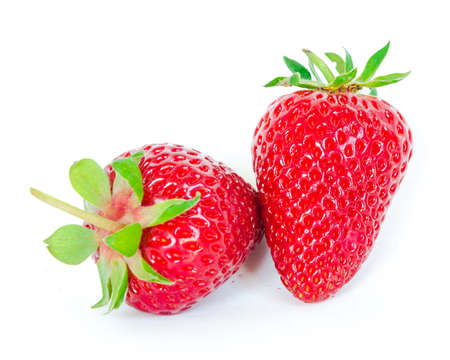 Two strawberries isolated on white background with copy space and clipping path. Fresh harvested homegrown strawberry fruit. Imagens