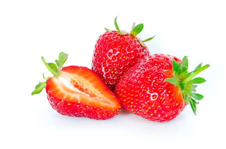 Close up two strawberries and a half cut isolated on white background with copy space and clipping path. Fresh harvested homegrown strawberry fruit. Imagens