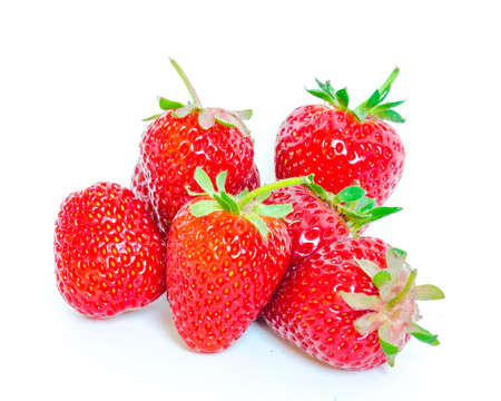 Group of strawberries isolated on white background with copy space and clipping path. Fresh harvested homegrown strawberry fruit. Imagens