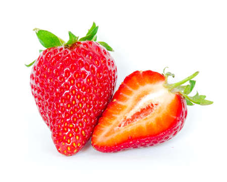 Single fruit and a half cut strawberry isolated on white background with copy space and clipping path. Fresh harvested homegrown strawberry fruit. Imagens