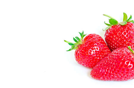 Studio shot strawberries isolated on white background with copy space. Fresh harvested homegrown strawberry fruit. Imagens
