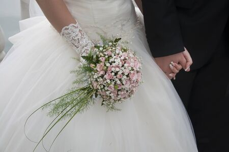 florists: The hand of the bride holds a bouquet Stock Photo