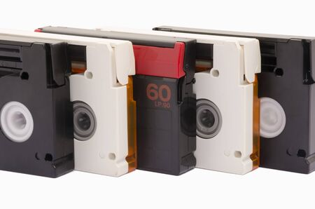 Old video cassettes on white background isolated photo