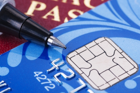 Credit card and passport with pen close up photo