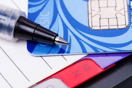 Credit card, diary and pen close up Stock Photo - 17123752