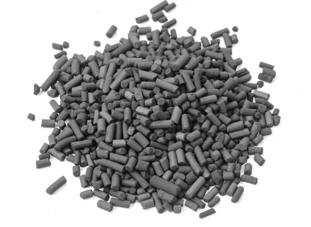 granules: Activated carbon granules on white background Stock Photo