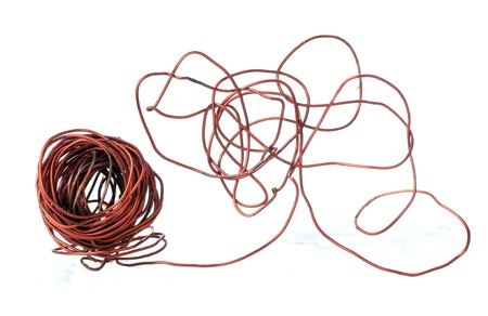 Old copper wire recyclable materials on white background photo