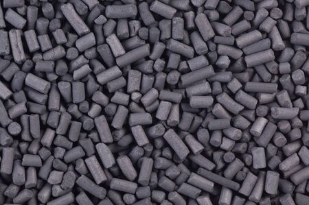 activated: Activated carbon granules abstract background Stock Photo