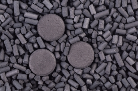 activated: Activated carbon granules and tablets  background