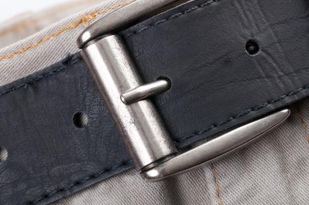 fasten: Fasten belt on bright jeans close up