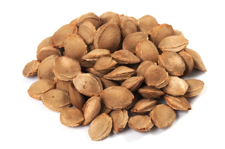 apricot kernels: A pile of apricot kernel on white with shadow