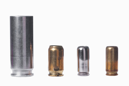 casings: Used bullet casings on white isolated
