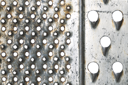 metal grater: Old metal grater on white as background close up