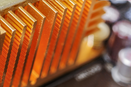 convection: Copper heat sink  on computer motherboard abstract background