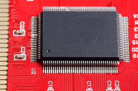 Computer chip on the red board close up
