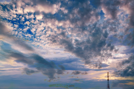 Mobile phone tower silhouette on a background of a stormy sky outdoor