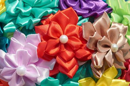 Homemade artificial colored flowers close up