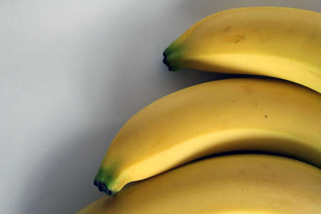 details of three banana on white background