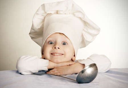 prodigy: The little boy in a suit of the cook Stock Photo