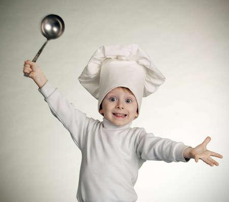 prodigy: The little boy in una tuta di cuoco