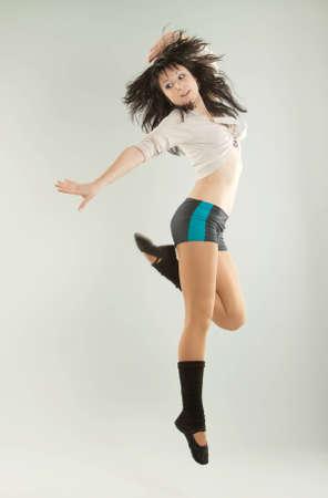 The beautiful girl dances photo