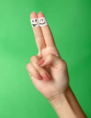 plea: Finger in bandage  The drawn mug  On a green background Stock Photo