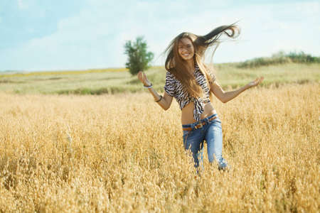 Happy girl in a yellow field photo
