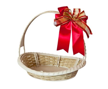 basket with  red ribbon  isolated on white background