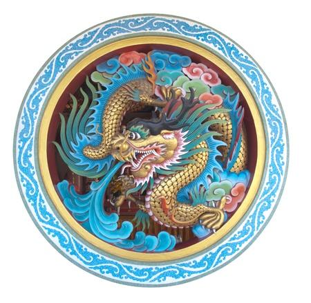 dragones: Antigua estatua del Drag�n de China contra el cielo azul Foto de archivo