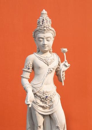 worshipping: Hindu God Vishnu over orange backgroun Stock Photo