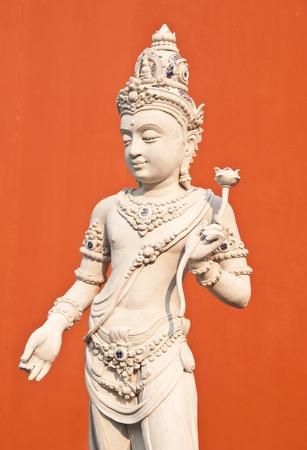 Hindu God Vishnu over orange backgroun Stock Photo