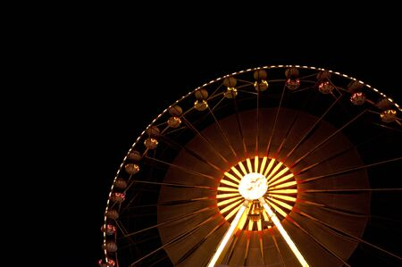 Ferris wheel at the fair ground at night photo