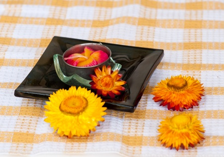 essences: Spa concept  with flower on fabric textile. Stock Photo