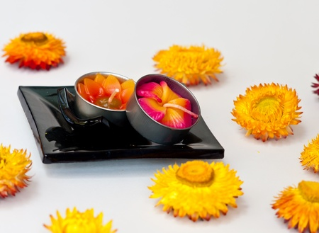 spa candle on black ceramic bowl in spa  conceps. photo