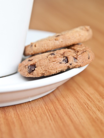 coffee cup with cookie on wood table  photo