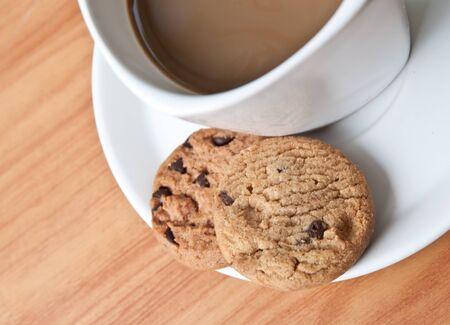 coffee cup with cookie on wood table Stock Photo - 13320193