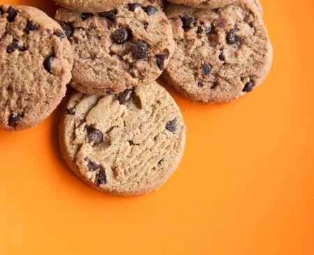 chocolate chips cookies in a dish on  the wood teble. Stock Photo - 13354150