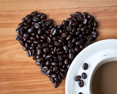 express feelings: Concept of love with coffee beans on wood texture. Stock Photo