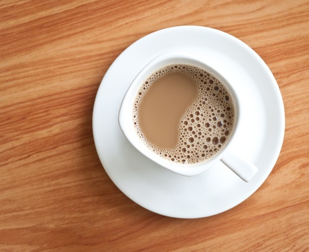 white coffee cup on wood texture. Stock Photo - 13387987