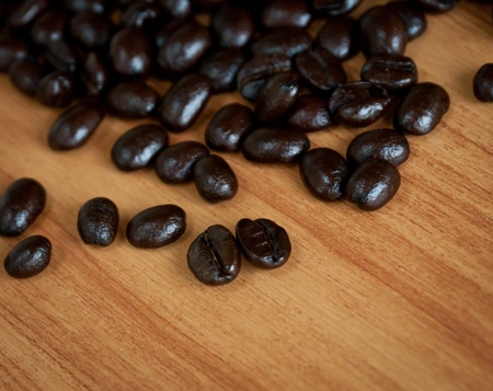 Roasted coffee  beans  on wood texture. photo
