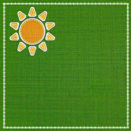 fabric style sun icon on colorful fabric background. photo