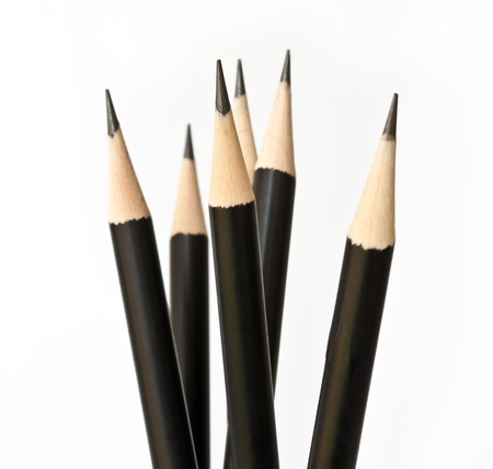close-up of black pencil isolated on white background  photo
