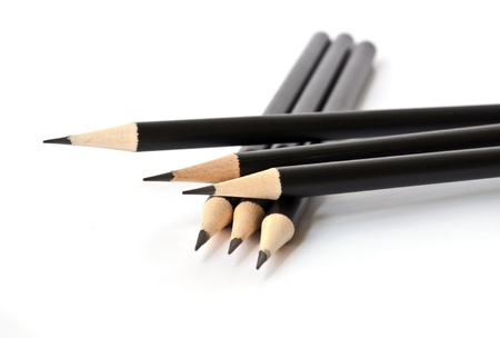 Black pencil isolated on white background  photo