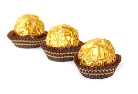 Chocolate balls with almond  in a gold foil paper. Stock Photo - 19054744