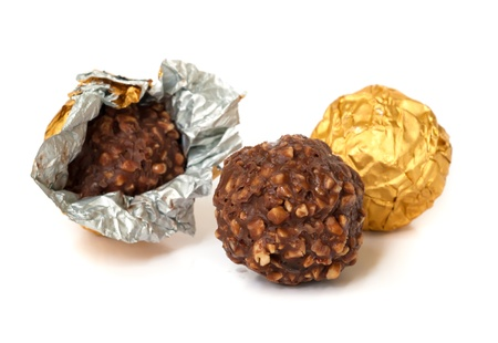 Chocolate balls with almond  in a gold foil paper. Stock Photo